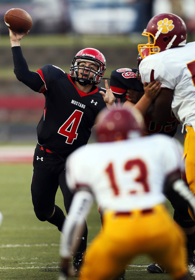 Photo - Mustang quarterback Frankie Edwards (4) passes during a high school football game between Mustang and Putnam City North in Mustang, Okla., Friday, Sept. 7, 2012. Photo by Nate Billings, The Oklahoman