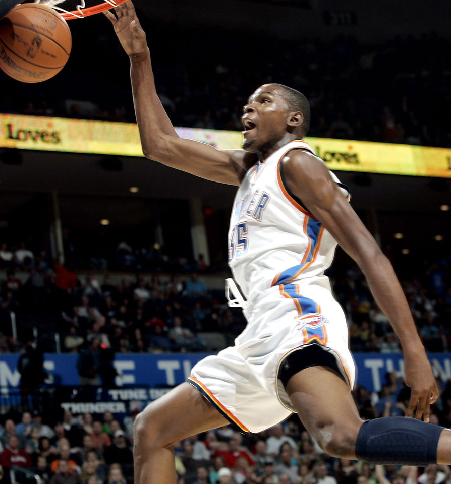 Oklahoma City\'s Kevin Durant slams a basket after a steal against Orlando during the NBA basketball game between the Orlando Magic and the Oklahoma City Thunder at the Ford Center in Oklahoma City, on Sunday, Nov. 8, 2009. By John Clanton, The Oklahoman