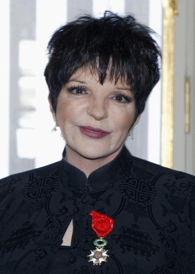 "FILE - This July 11, 2011, file photo, shows actress and singer Liza Minnelli wearing the medal of Officer of the Legion of Honor she was awarded in Paris. The restored ""Cabaret"" is opening the TCM Classic Film Festival that runs Thursday, April 12, 2012, to Sunday in Los Angeles. Liza Minnelli and Joel Grey, the movie's stars, were scheduled to attend the ceremony marking the movie's 40th anniversary. (AP Photo/Remy de la Mauviniere, File)"