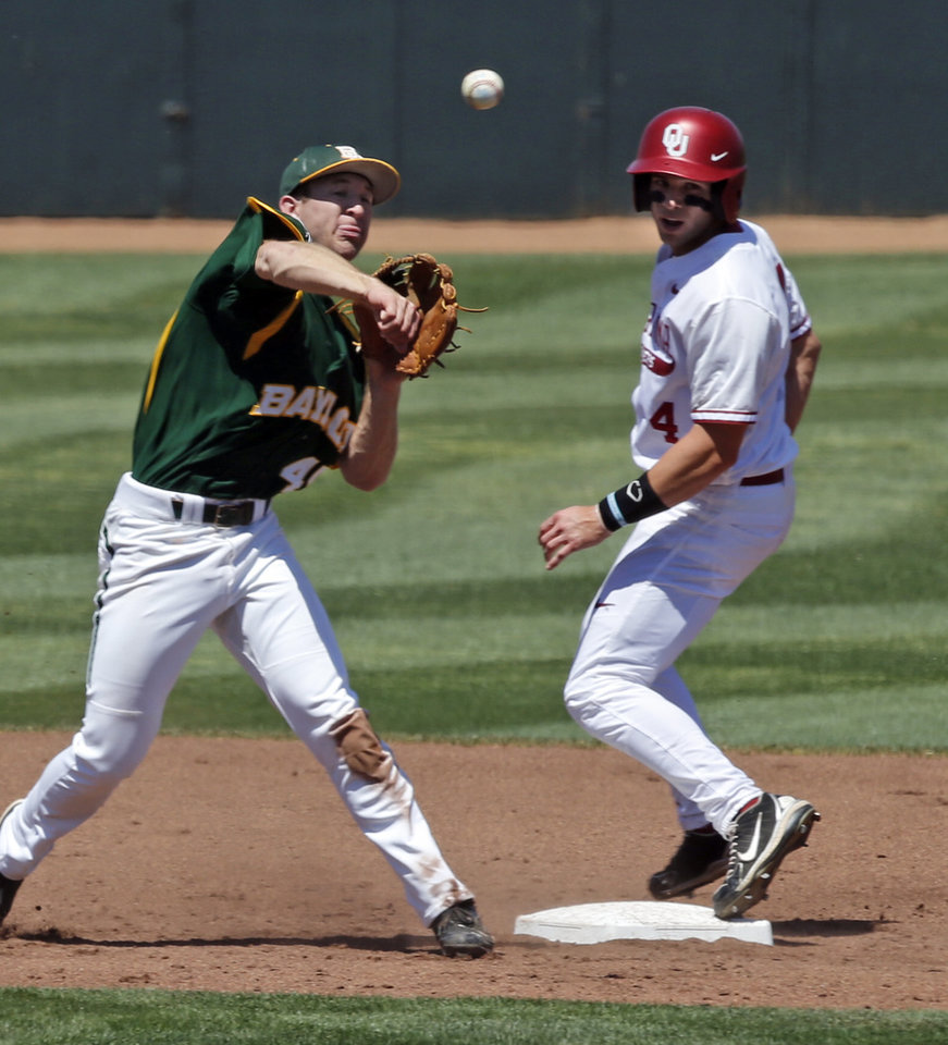 Photo - Oklahoma's Hunter Haley (4) is forced out at second but the double play toss by Hayden Ross is bobbled by the catcher as the University of Oklahoma Sooner (OU) baseball team plays the Baylor Bears in college baeball at L. Dale Mitchell Park on May 3, 2014 in Norman, Okla. Photo by Steve Sisney, The Oklahoman