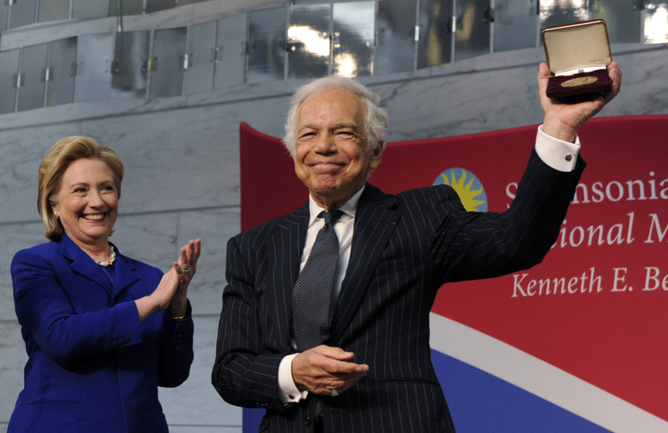 "Photo - Former Secretary of State Hillary Rodham Clinton applauds Designer Ralph Lauren as he receives the James Smithson Bicentennial Medal ""for his embodiment of the American experience through the medium of fashion, design and philanthropy"