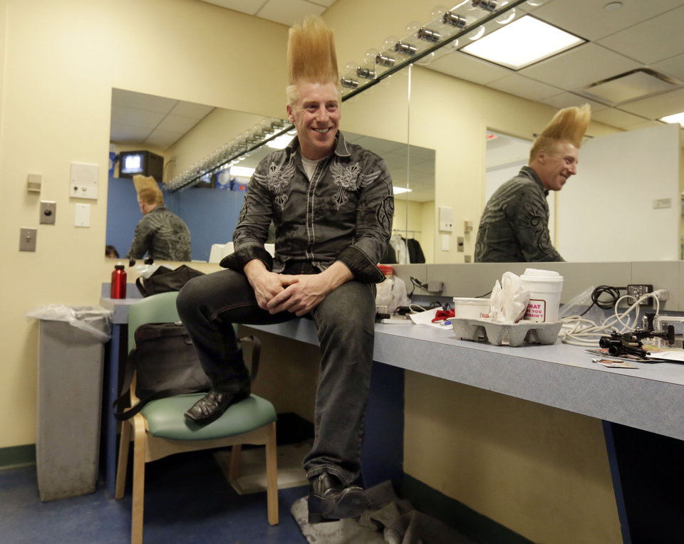 "This March 23, 2013 photo shows performer Bello Nock in his dressing room at the New Victory Theater, before performing in ""Bello Mania,"" in New York.  Nock, a seventh-generation circus performer, is never offstage during the 90-minute performance, which combines slapstick clowning with death-defying aerial stunts. He performs through March 31 at the New Victory before moving on to the Canadian side of Niagara Falls and then a 10-week stint at the Beau Rivage Casino in Biloxi, Miss.  (AP Photo/Richard Drew)"