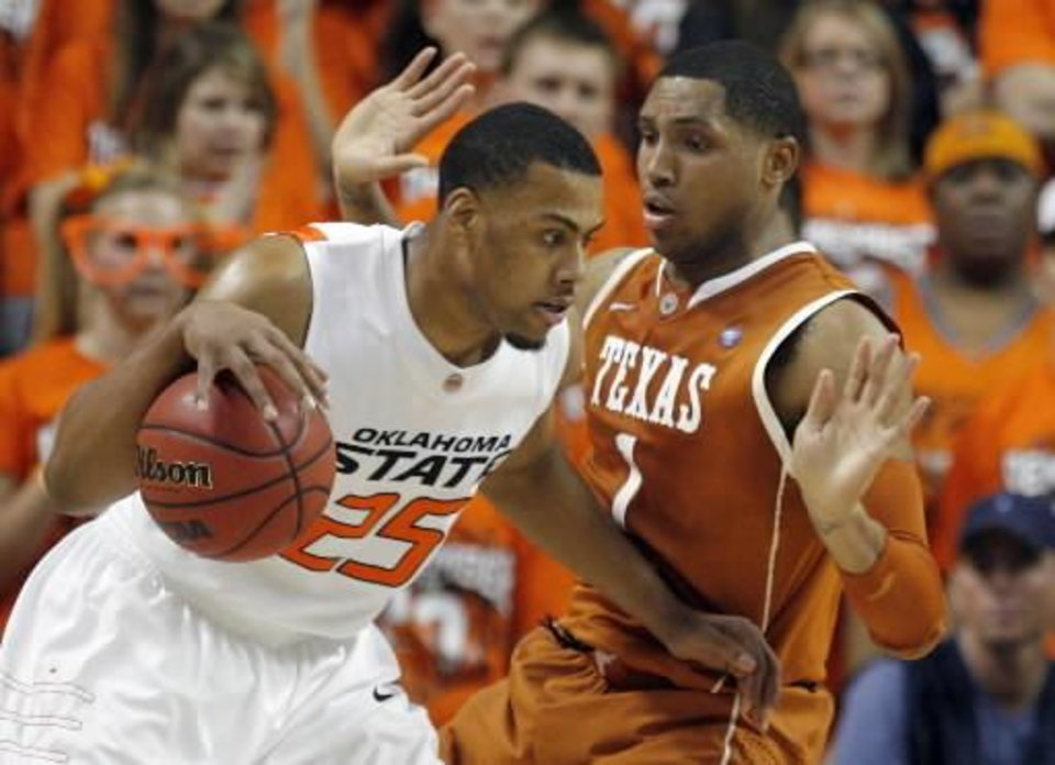 Oklahoma State's Darrell Williams (25) drives to the basket as Texas' Gary Johnson (1) defends during the college basketball game between Oklahoma State University and Texas, Wednesday, Jan. 26, 2011, at Gallagher-Iba Arena in Stillwater, Okla. Photo by Sarah Phipps