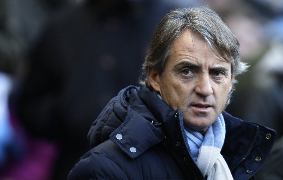 Photo - Manchester City's manager Roberto Mancini takes to the touchline before his team's 1-1 draw against Everton during their English Premier League soccer match at The Etihad Stadium, Manchester, England, Saturday, Dec. 1, 2012. (AP Photo/Jon Super)