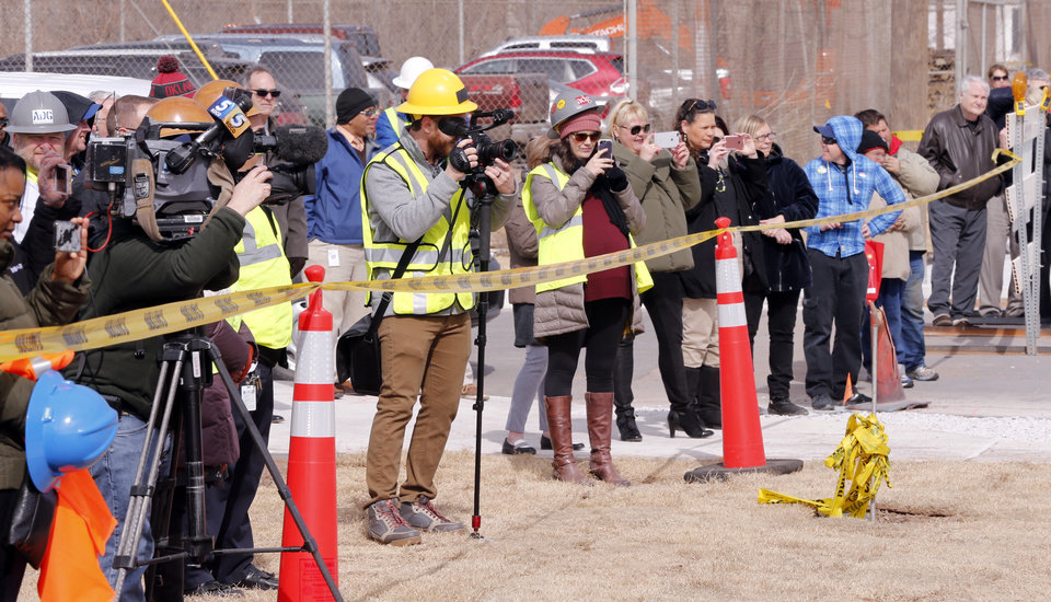 Photo - Onlookers watched as the streetcar arrived Tuesday. [Photo by Steve Sisney, The Oklahoman]