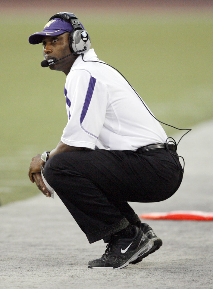 Photo - UW head coach Tyrone Willingham watches from the sidelines in the second half during the college football game between Oklahoma and Washington at Husky Stadium in Seattle, Wash., Saturday, September 13, 2008. OU beat UW, 55-14. BY NATE BILLINGS, THE OKLAHOMAN