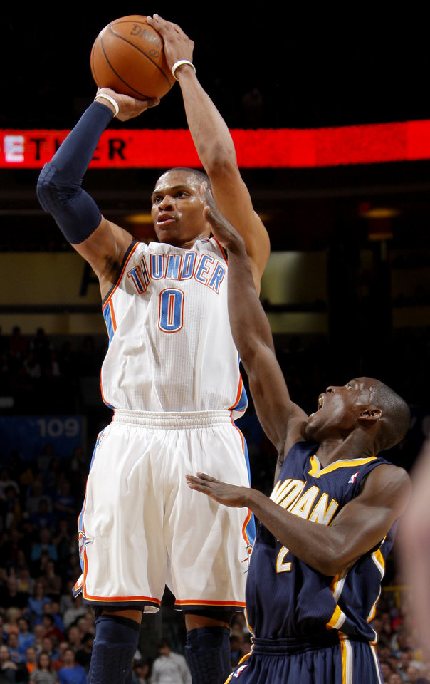 Photo - Oklahoma City's Russell Westbrook (0) shoots the ball beside Indiana's Darren Collison (2) during the NBA basketball game between the Oklahoma City Thunder and the Indiana Pacers at the Oklahoma City Arena, Wednesday, March 2, 2011. Photo by Bryan Terry, The Oklahoman