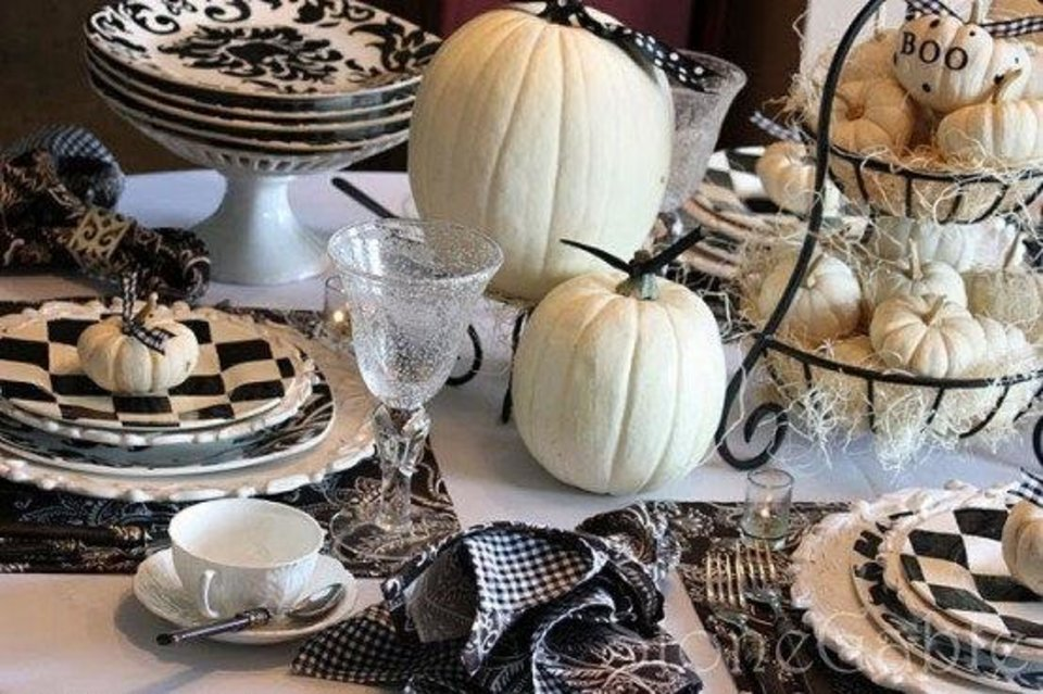 Photo - Black and white is a color scheme perfect for a contemporary, chic holiday celebration. Decorate white pumpkins with black paint using stencils, or leave them bare. Add a black-and-white striped or patterned table runner and mix and match patterns, sticking within the color scheme. Photo from http://www.digsdigs.com.