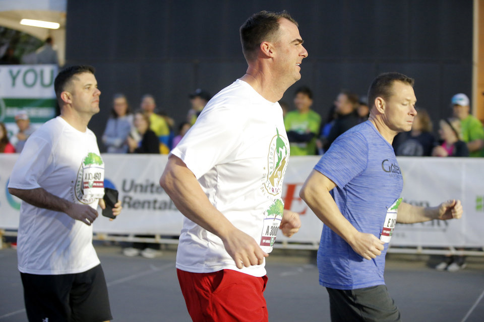Photo - Gov. Kevin Stitt starts the Oklahoma City Memorial Marathon in Oklahoma City, Sunday, April 28, 2019. [Bryan Terry/The Oklahoman]
