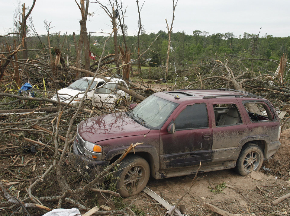 Debris is remains on the hillside north of Highway 9 near SE 192 on Wednesday, May 12, 2010, in Norman, Okla. A mother died and her children were injured at this location during Monday\'s severe storms. Photo by Steve Sisney, The Oklahoman