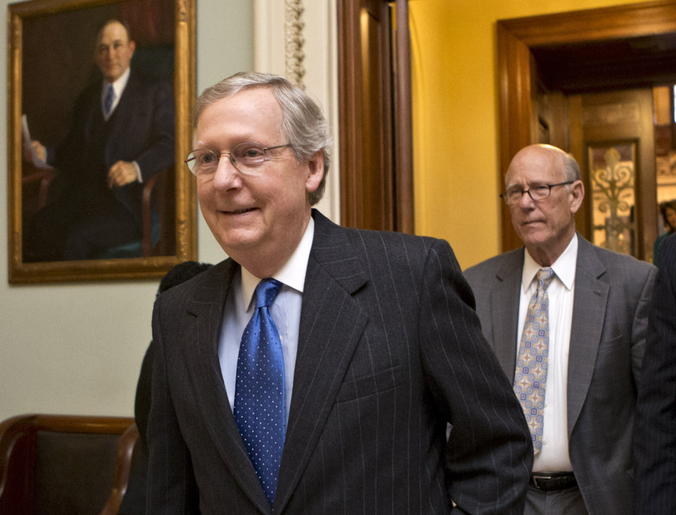 FILE - This Dec. 30, 2012 file photo shows Senate Minority Leader Mitch McConnell of Ky., followed by Sen. Pat Roberts, R-Kansas leaving the Senate chamber on Capitol Hill in Washington. President Barack Obama says he won't let Republicans threaten a debt ceiling crisis to extract deeper federal spending cuts, but congressional Republicans say he has no choice. The tough talk suggests this year\'s political fight could be even nastier and more nerve-grating than the