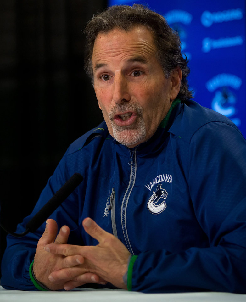 Photo - Vancouver Canucks' head coach John Tortorella responds to questions during an end of season news conference in Vancouver, British Columbia on Monday April 14, 2014.  The Canucks missed the playoffs this year.  (AP Photo/The Canadian Press, Darryl Dyck)