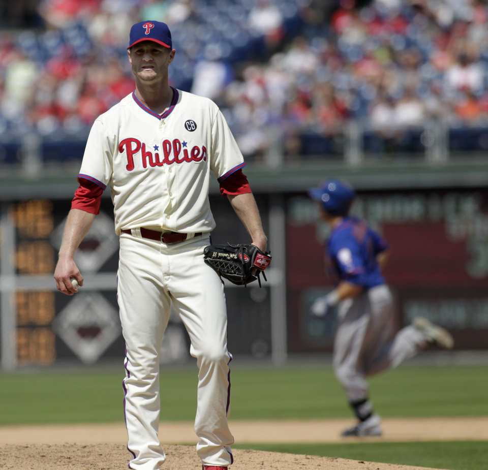 Photo - Philadelphia Phillies starting pitcher Kyle Kendrick stands on the mound after New York Mets' Travis d'Arnaud hit a solo home run  in the fifth inning of a baseball game Sunday, Aug. 10, 2014, in Philadelphia. (AP Photo/H. Rumph Jr)