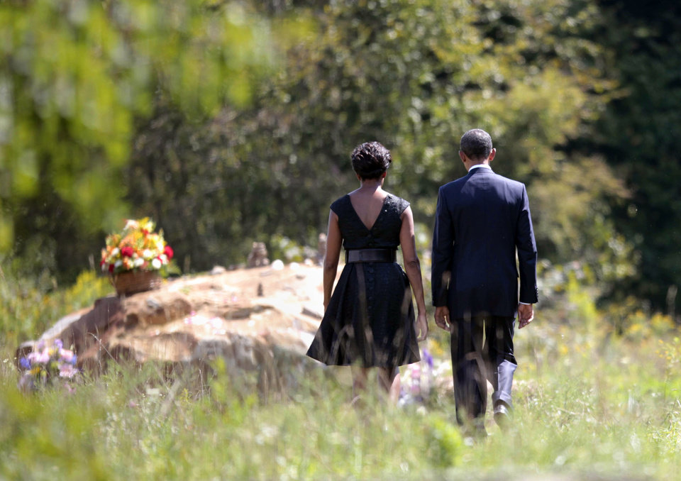 Photo -   President Barack Obama and first lady Michelle Obama walk to the crash site of Flight 93 during their visit to the Flight 93 National Memorial Sunday, Sept., 11, 2011, in Shanksville, Pa., on the 10th anniversary of Sept. 11. (AP Photo/Pablo Martinez Monsivais)