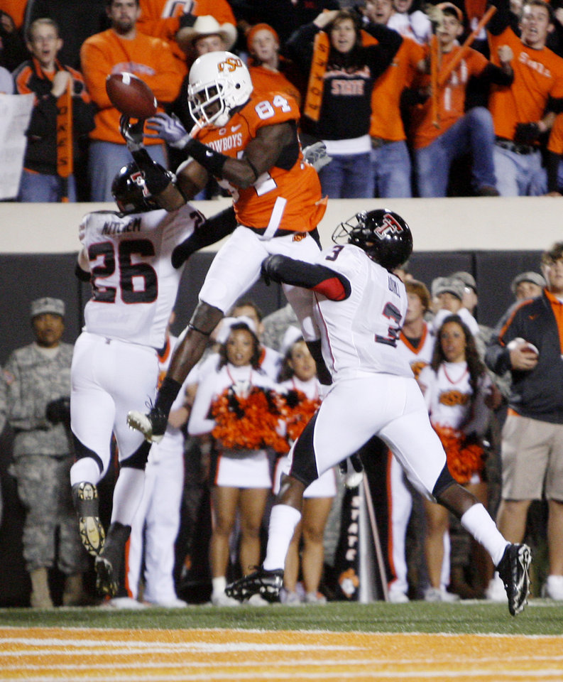 Cowboy Hubert Anyiam (84) grabs a touchdown pass against Franklin Mitchem (26) and Jamar Wall (3) during the college football game between Oklahoma State University (OSU) and Texas Tech University at Boone Pickens Stadium in Stillwater, Okla. Saturday, Nov. 14, 2009. Photo by Sarah Phipps, The Oklahoman