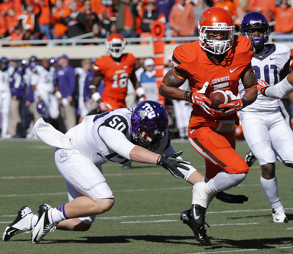 Oklahoma State's Josh Stewart (5) runs past TCU's James Power (50) for a touchdown on a kick return during a college football game between the Oklahoma State University Cowboys (OSU) and the Texas Christian University Horned Frogs (TCU) at Boone Pickens Stadium in Stillwater, Okla., Saturday, Oct. 19, 2013. Photo by Chris Landsberger, The Oklahoman