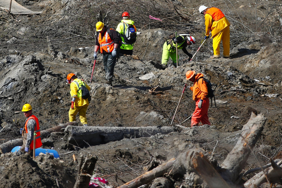 Photo - Workers dig at a much drier mudslide site on the west side at the west site of the mudslide on Highway 530 near mile marker 37, near Oso, Wash., on Tuesday, April 1, 2014. The death toll from the March 22 mudslide has increased to 28. (AP Photo/The Seattle Times, Lindsey Wasson)  SEATTLE OUT; USA TODAY OUT; MAGS OUT; TELEVISION OUT; NO SALES; MANDATORY CREDIT TO BOTH THE SEATTLE TIMES AND THE PHOTOGRAPHER