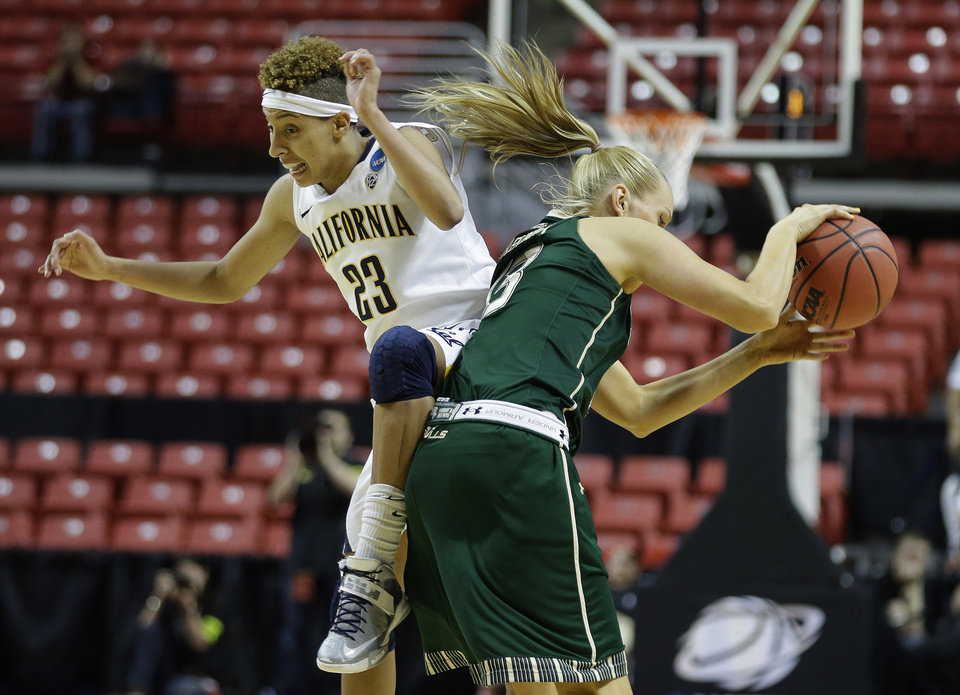 Photo - California guard Layshia Clarendon (23) collides into South Florida guard Inga Orekhova (13) during overtime play of a second-round game against South Florida in the women's NCAA college basketball tournament in Lubbock, Texas, Monday, March 25, 2013. California won 82-78 in overtime. (AP Photo/LM Otero)