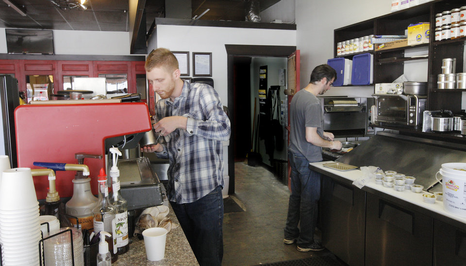 Photo - Employee Andrew Giles and manager Jason Wegand work Thursday behind the counter at the District House, 1755 NW 16 Street, in the Plaza District in Oklahoma City .  Photo by Paul B. Southerland, The Oklahoman  PAUL B. SOUTHERLAND -  PAUL B. SOUTHERLAND