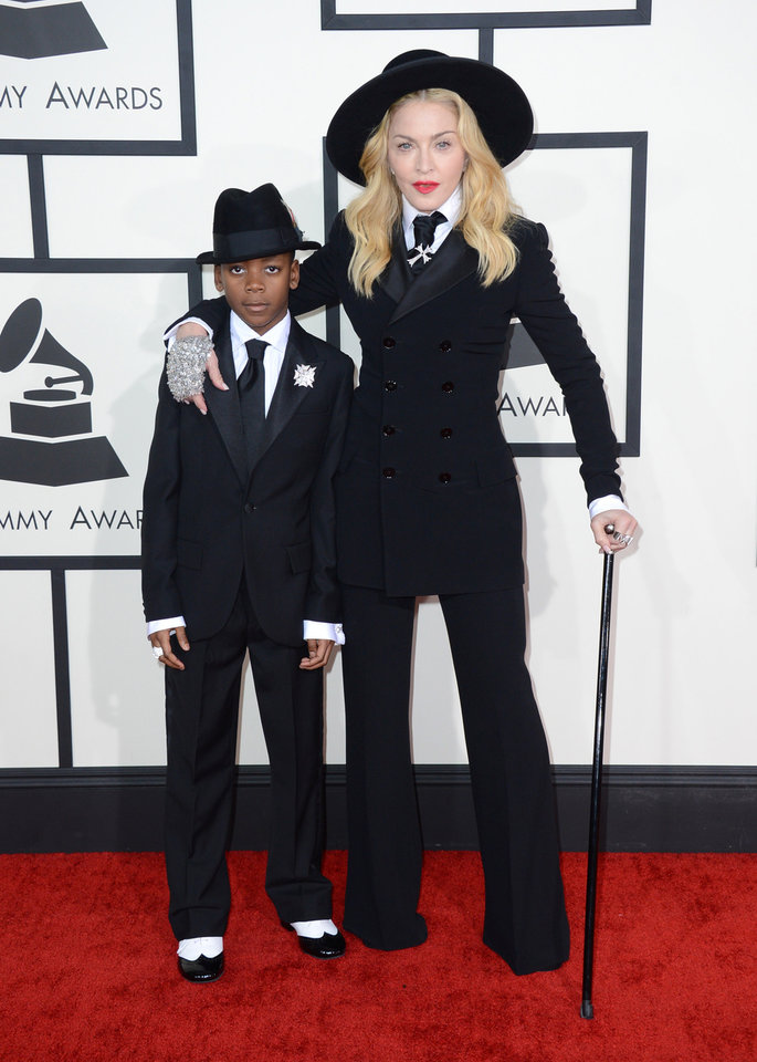 Photo - Madonna, right, arrives with her son David at the 56th annual Grammy Awards at Staples Center on Sunday, Jan. 26, 2014, in Los Angeles. (Photo by Jordan Strauss/Invision/AP)