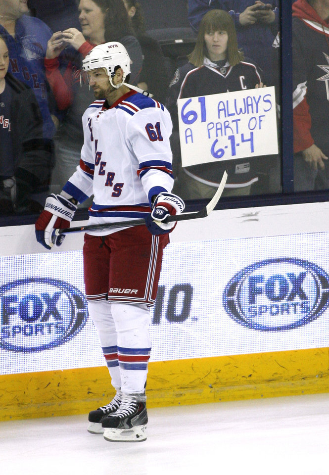 Photo - New York Rangers' Rick Nash prepares to play against the Columbus Blue Jackets, his former team, in an NHL hockey game for the first time since he was traded, Friday, March 21, 2014, in Columbus, Ohio. The number 614 refers to the Columbus area code. (AP Photo/Mike Munden)