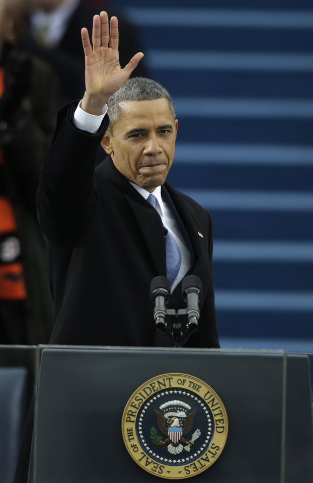 President Barack Obama waves after his speech at the ceremonial swearing-in at the U.S. Capitol during the 57th Presidential Inauguration in Washington, Monday, Jan. 21, 2013. (AP Photo/Pablo Martinez Monsivais)