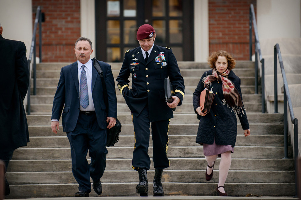 Photo - Brig. Gen. Jeffrey Sinclair leaves the courthouse with his lawyers Richard Scheff, left, and Ellen C. Brotman, following a day of motions Tuesday, March 4, 2014, at Fort Bragg, N.C. Less than a month before Sinclair's trial on sexual assault charges, the lead prosecutor broke down in tears Tuesday as he told a superior he believed the primary accuser in the case had lied under oath. (AP Photo/The Fayetteville Observer, James Robinson)