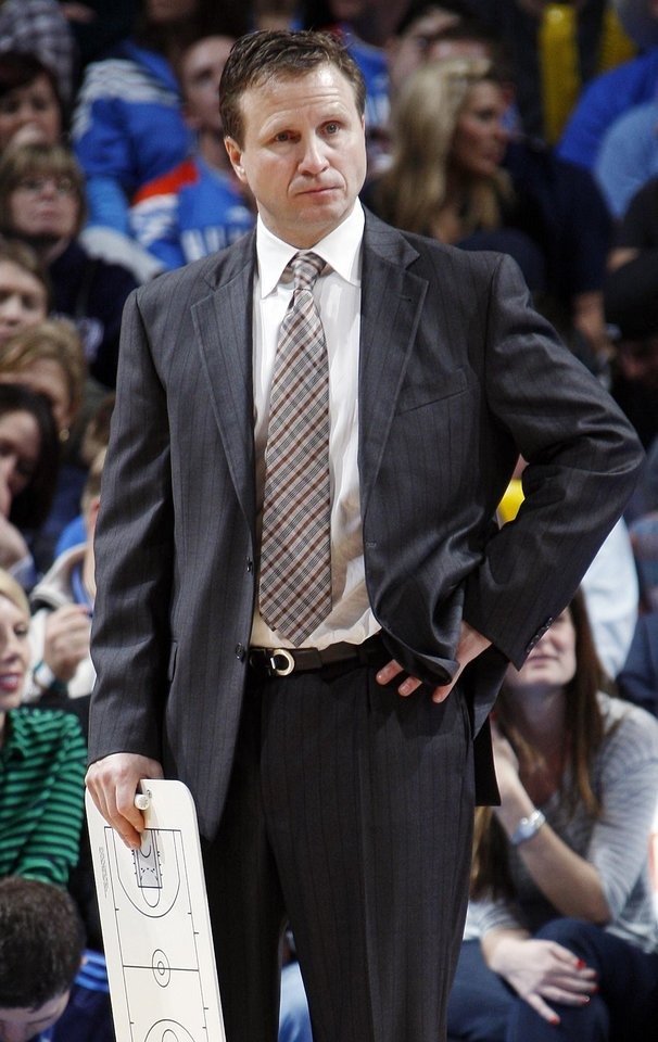 Photo - Oklahoma City head coach Scott Brooks stands on the court during a break in the action of the NBA basketball game between the Oklahoma City Thunder and the Golden State Warriors at the Chesapeake Energy Arena in Oklahoma City, Friday, Feb. 17, 2012. The Thunder won, 110-87. Photo by Nate Billings, The Oklahoman