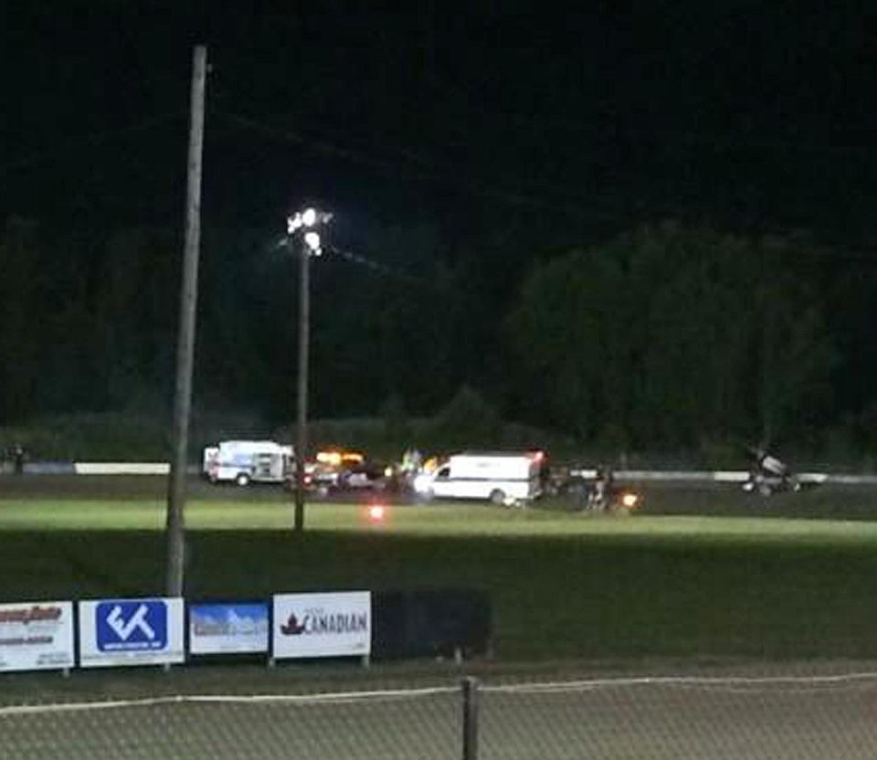 Photo - This image provided by Logan Messerly shows ambulances on the scene at Canandaigua Motorsports Park on Saturday Aug. 9, 2014 in Canandaigua, N.Y. Authorities are investigating a serious crash that injured one person at a New York dirt track where Tony Stewart was racing on the eve of a NASCAR race. (AP Photo/Logan Messerly)