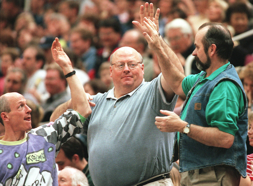 Jazz superfan Jon Sudbury high fives his pals after a Jazz basket. He's had the same seat at games for more than 30 years and says Thunder fans will find out that the playoffs are a whole different ballgame than the regular season.Photo by Al Hartmann, The Salt Lake Tribune.