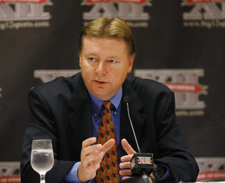 Photo - OKLAHOMA STATE UNIVERSITY: OSU women's college basketball coach Kurt Budke answers questions from sports writers during the morning session of the Big 12 Basketball Media Day at the Cox Convention Center Wednesday,  October 22, 2008.  BY JIM BECKEL, THE OKLAHOMAN ORG XMIT: KOD