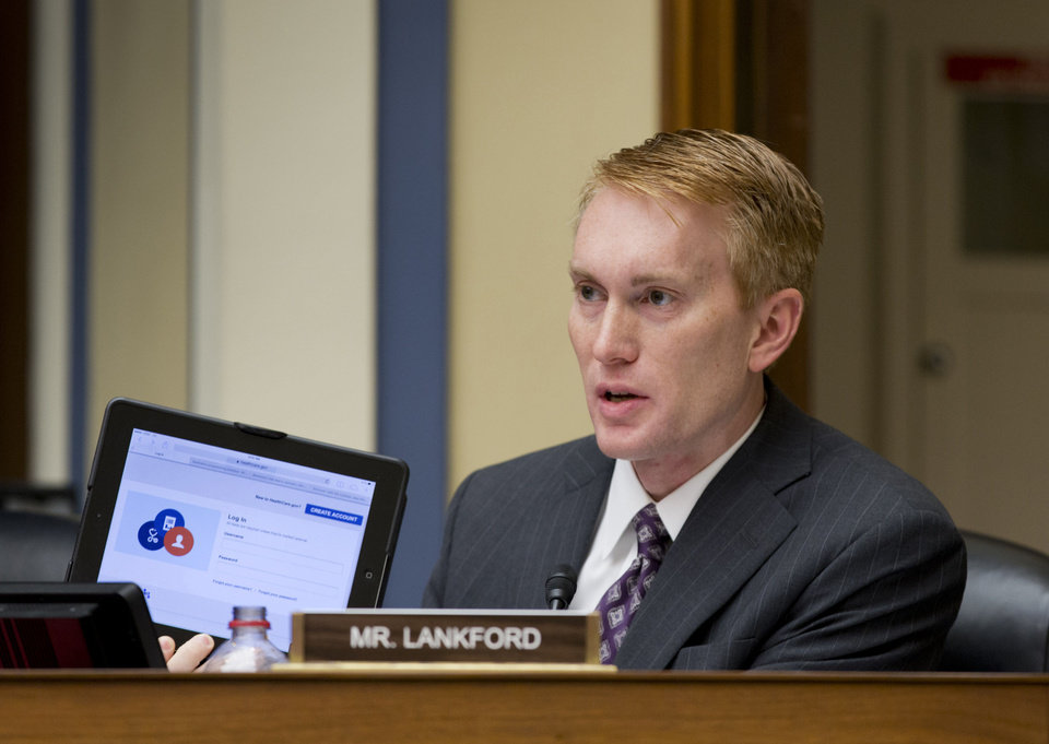 In a Nov. 13, 2013, photo, Rep. James Lankford, R-Oklahoma City, a member of the House Oversight Committee, holds a tablet displaying the healthcare.gov website as he questions Obama administration technology officials about problems with implementation of the Obamacare healthcare program, on Capitol Hill in Washington.  (AP Photo/J. Scott Applewhite) <strong>J. Scott Applewhite</strong>