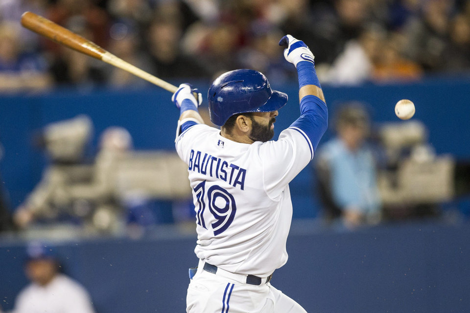 Photo - Toronto Blue Jays' Jose Bautista hits a foul ball against the Houston Astros during the third inning of a baseball game Wednesday, April 9, 2014, in Toronto. (AP Photo/The Canadian Press, Chris Young)