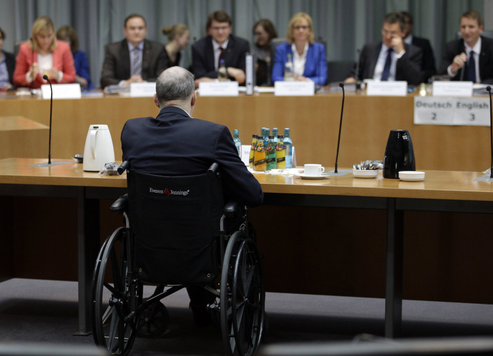 Photo - The formerUS National Security Agency, NSA,  employee William Binney, in wheelchair, waits for his questioning by the German parliamentary NSA investigation committee in Berlin, Germany, Thursday, July 3, 2014. The committee investigates  the NSA  surveillance  activities, that also included the tapping of German Chancellor Angela Merkel. (AP Photo/Michael Sohn)