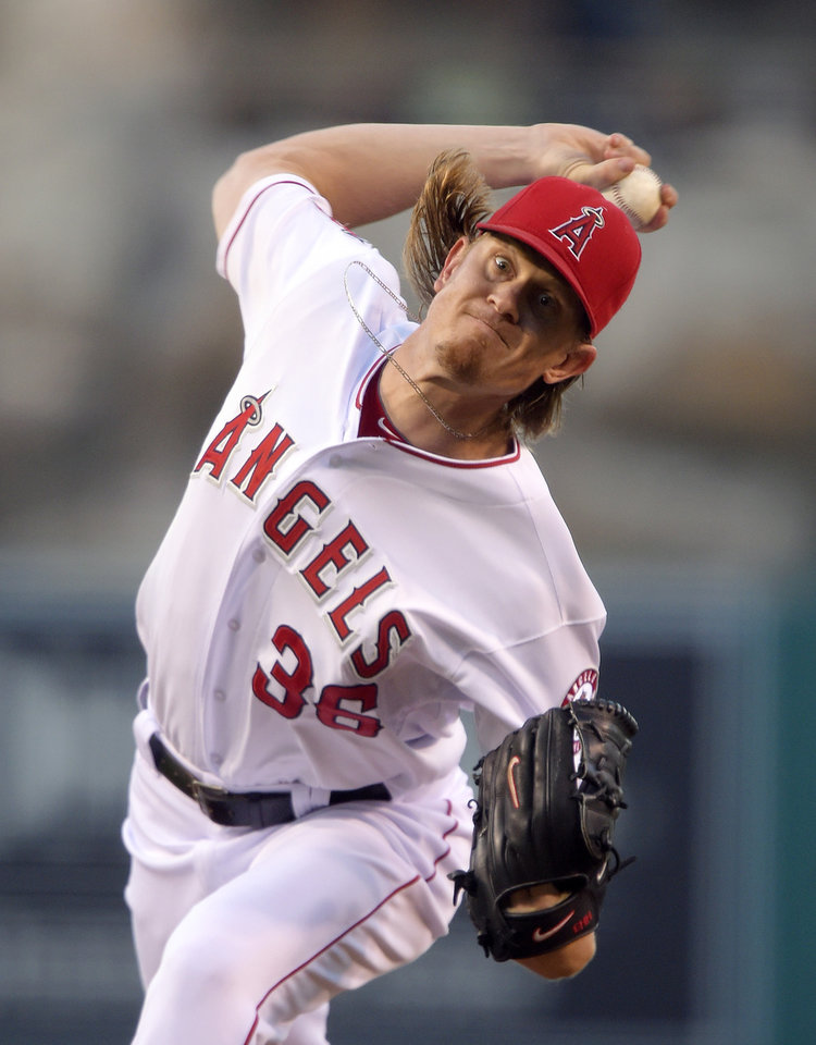 Photo - Los Angeles Angels starting pitcher Jered Weaver throws to the plate during the first inning of a baseball game against the Philadelphia Phillies, Wednesday, Aug. 13, 2014, in Anaheim, Calif. (AP Photo/Mark J. Terrill)