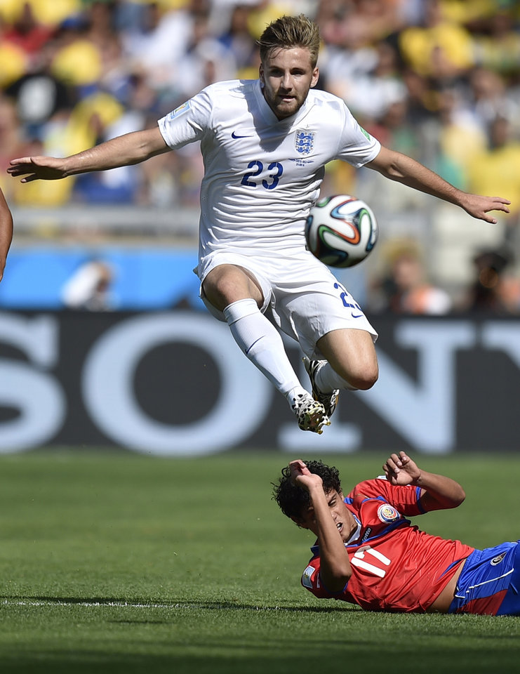 Photo - England's Luke Shaw controls the ball over Costa Rica's Yeltsin Tejeda during the group D World Cup soccer match between Costa Rica and England at the Mineirao Stadium in Belo Horizonte, Brazil, Tuesday, June 24, 2014. (AP Photo/Martin Meissner)