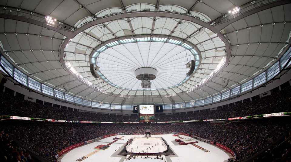 Photo - The Vancouver Canucks and Ottawa Senators play during the first period of an NHL Heritage Classic hockey game in Vancouver, British Columbia,, on Sunday, March 2, 2014. (AP Photo/The Canadian Press, Darryl Dyck)