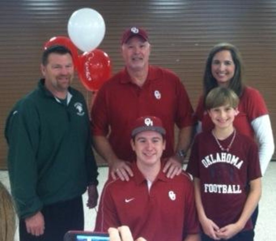 Photo - Oklahoma signee Christian Daimler, seated, poses with, from left, Houston Stratford coach Dean Allen, father Bob Daimler, mother Tracy Daimler and brother Jett Daimler, after signing his letter of intent to attend OU. PHOTO PROVIDED