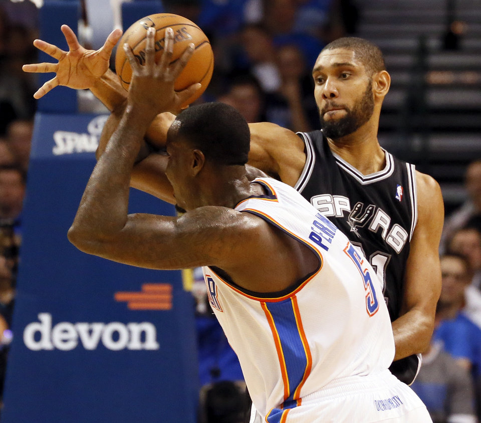 San Antonio's Tim Duncan (21) defends Oklahoma City's Kendrick Perkins (5) during an NBA basketball game between the Oklahoma City Thunder and the San Antonio Spurs in Oklahoma City Monday, Dec. 17, 2012. Photo by Nate Billings, The Oklahoman