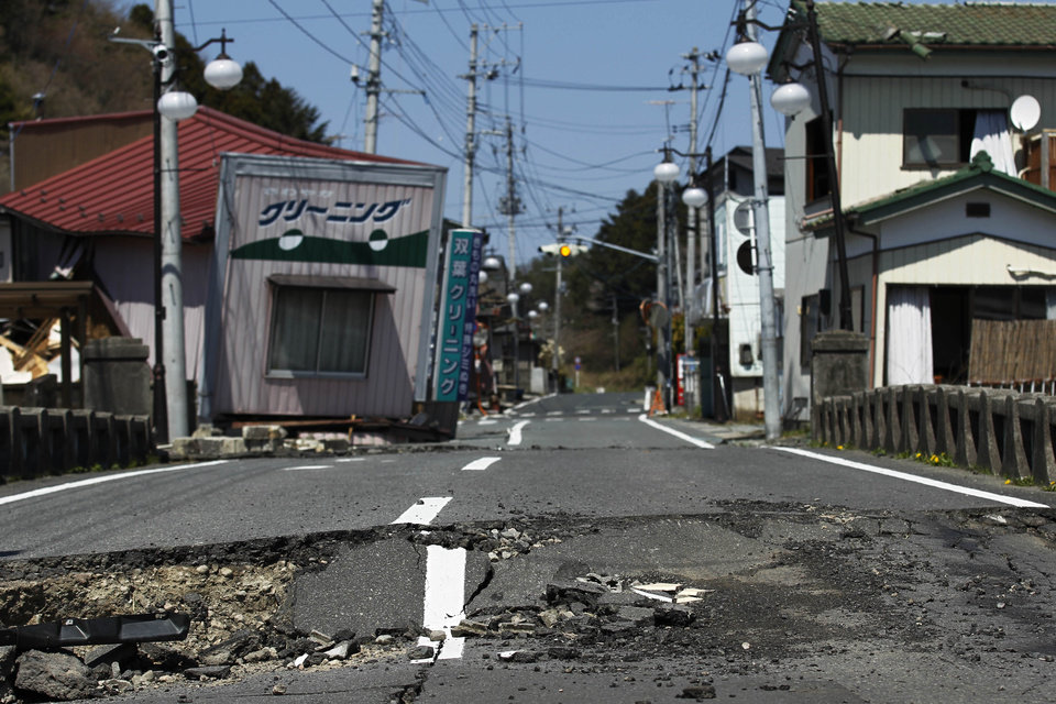 "Photo - FILE - This April 17, 2011 file photo shows damage on a street in Futaba, the town where the tsunami crippled Fukushima Dai-ichi nuclear power plant is located, in Fukushima Prefecture, northeastern Japan. After the March 2011 disaster, of all Fukushima communities forced to evacuate, Futaba chose the farthest spot from the nuclear plant - an abandoned high school in Saitama Prefecture, near Tokyo. Atsushi Funahashi, director of ""Nuclear Nation,"" documented a story of the residents of Futaba in the film. The catastrophe in Japan has set off a flurry of independent films telling the stories of regular people who became overnight victims, stories the creators feel are being ignored by mainstream media and often silenced by the authorities. Nearly two years after the quake and tsunami disaster, the films are an attempt by the creative minds of Japan's movie industry not only to confront the horrors of the worst nuclear disaster since Chernobyl, but also as a legacy and to empower the victims by telling their story for international audiences. (AP Photo/Hiro Komae, File)"