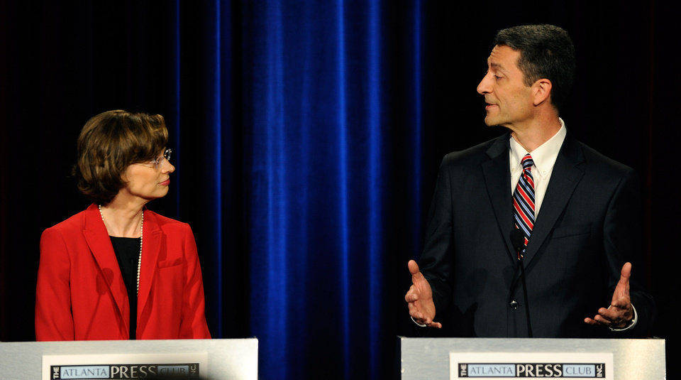 Photo - Democratic senatorial candidates Michelle Nunn, the former CEO of Points of Light from Atlanta, left, and Branko Radulovacki, a psychiatrist from Atlanta, participate in a debate at the Georgia Public Broadcasting studio, Sunday, May 11, 2014, in Atlanta. (AP Photo/David Tulis)