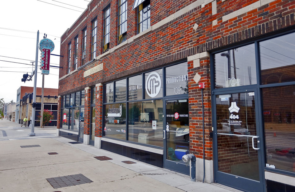 Photo - The Film Exchange building, 700 W Sheridan Ave., was boarded up just a few years ago, but is now home to Joey's Pizzeria and IAO Gallery.  CHRIS LANDSBERGER