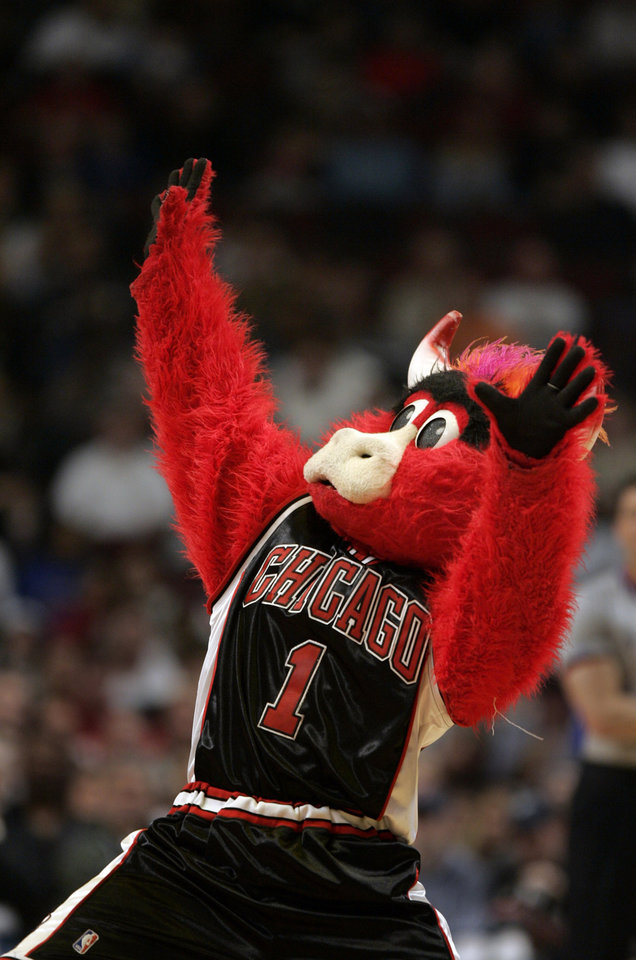 Photo - ** FILE ** Chicago Bulls mascot Benny the Bull dances during a time in this April 1, 2006 file photo in Chicago. Some days it just doesn't pay to get out of bed and strap on the old Bull head. Benny the Bull found that out the other day when he was busted for allegedly punching an off-duty officer. (AP Photo/Jeff Roberson) ORG XMIT: NY160