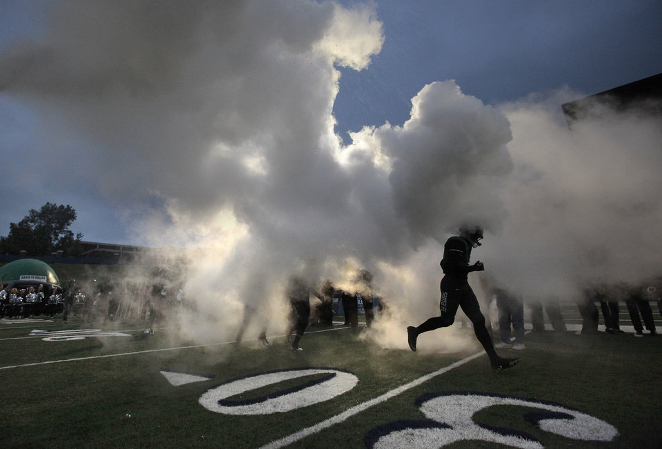 Edmond Santa Fe runs onto the field before the high school football game between Edmond Santa Fe and Edmond North at Wantland Stadium in Edmond, Okla., Wednesday, Jan. 23, 2008. Photo by Sarah Phipps, The Oklahoman