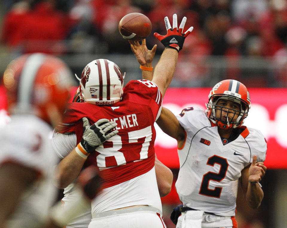 Photo -   Illinois quarterback Nathan Scheelhaase (2) throw against Wisconsin defensive lineman Ethan Hemer (87) during the second half of an NCAA college football game on Saturday, Oct. 6, 2012, in Madison, Wis. Wisconsin won 31-14. (AP Photo/Andy Manis)