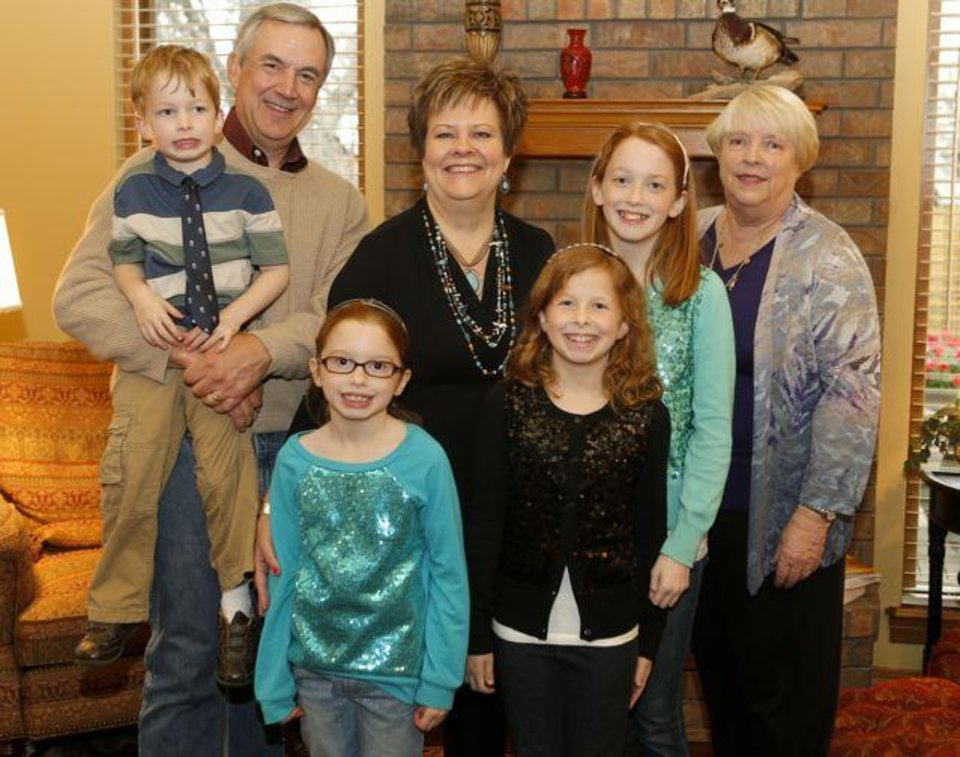 Front row of children from left; Brecken Cash, 4, Lorelei Cash, 7, Tierney Cash 10, and McKenna Cash, 12, with John Brown, back left, Sherri Brown, back center, and Barbara Brown pose for a photo during the Mary Ann and Jim Markey's 50th anniversary party in Edmond, Saturday, March 23, 2013. Photo by Bryan Terry, The Oklahoman
