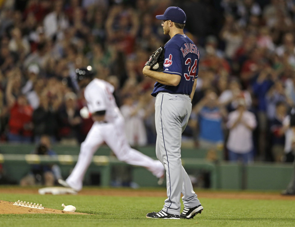 Photo - Cleveland Indians starting pitcher Zach McAllister (34) watches Boston Red Sox designated hitter David Ortiz round the bases on a three-run home run during the third inning of a baseball game at Fenway Park in Boston, Thursday, May 23, 2013. (AP Photo/Charles Krupa)