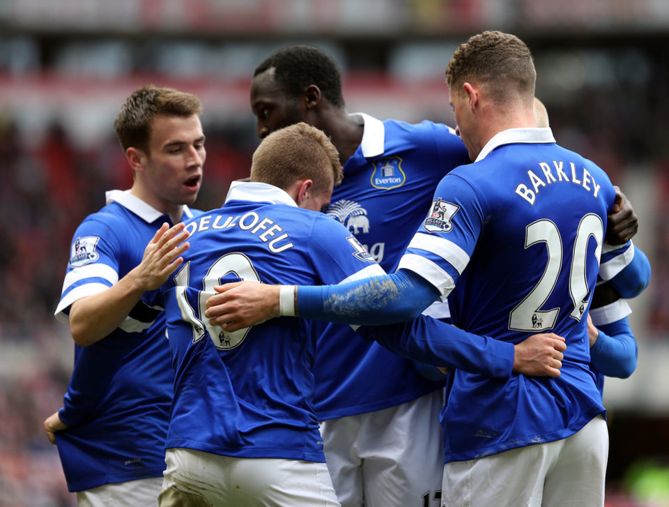 Photo - Everton's Gerard Deulofeu, center, celebrates after his shot was turned into the goal by Sunderland's Wes Brown during their English Premier League soccer match at the Stadium of Light, Sunderland, England, Saturday, April 12, 2014. (AP Photo/Scott Heppell)