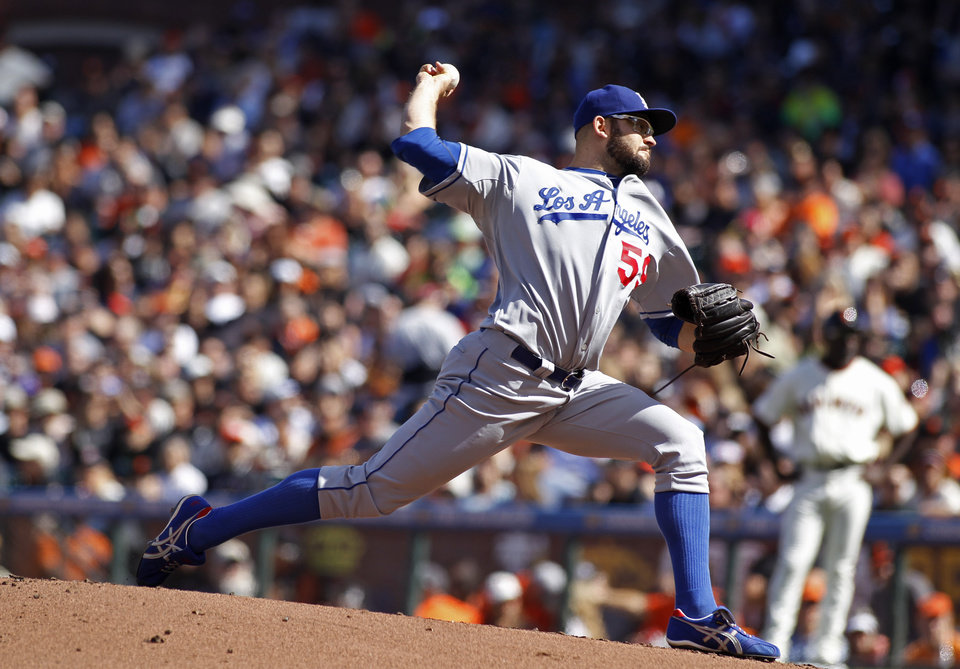 Photo - Los Angeles Dodgers pitcher Stephen Fife throws to the San Francisco Giants during the first inning of a baseball game in San Francisco, Saturday, July 6, 2013. (AP Photo/George Nikitin)