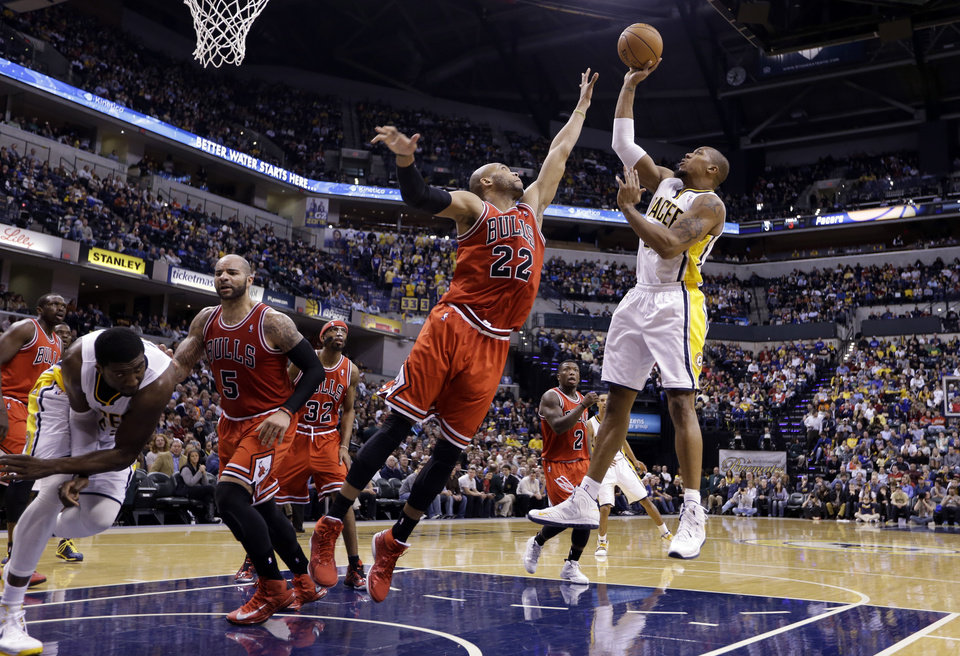 Indiana Pacers forward David West, right, hits a shot over Chicago Bulls forward Taj Gibson in the second half of an NBA basketball game in Indianapolis, Monday, Feb. 4, 2013. The Pacers defeated the Bulls 111-101. (AP Photo/Michael Conroy)